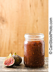 Sweet fig jam on wooden table