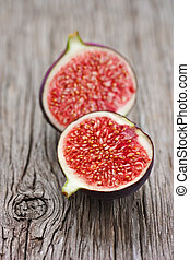 Sweet ripe fig on an old wooden board.