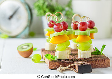 Sweet finger food with various fruits and mint for party