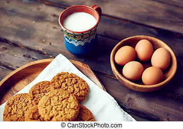 Sweet food - Close-up of cookies with eggs and cup of milk