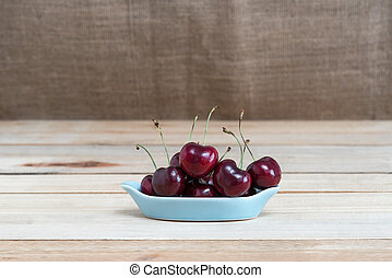 Sweet fresh cherry on wooden