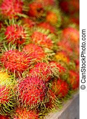Sweet fruits rambutan in the market