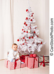 baby boy playing with Christmas tree decoration