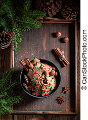 Sweet gingerbread cookies for Christmas with pinecone
