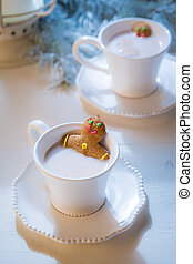 Sweet gingerbread man in hot chocolate for Christmas