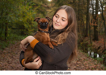 Sweet girl and her small dog
