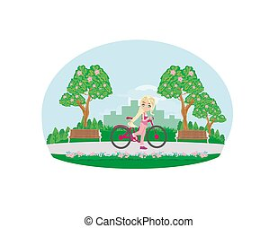 sweet girl on a bike in the park