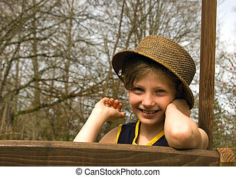 Sweet Girl Smiling With Hat Outside