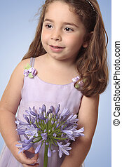 Sweet girl with lily flower