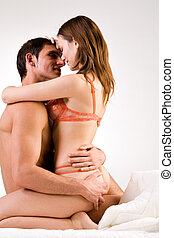 Sweet girlfriend - Young adult couple in the studio hugging