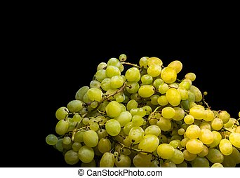 Sweet green grapes on a black background
