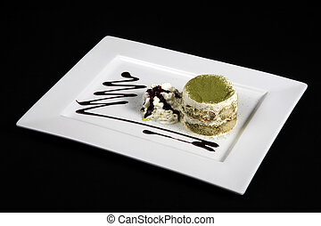 sweet green tea in white plate on a black background