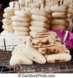 Sweet grilled bananas at asian food market