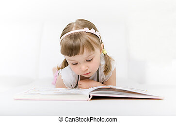 little girl reading book