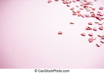Sweet hearts on a pink background, with space for text. Valentine's Day. Love concept. Mother's day background.