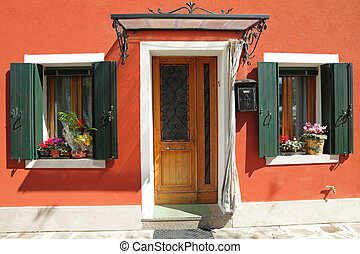 sweet home - entrance to the typical vivid painted house...