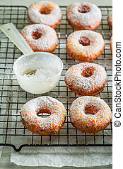 Sweet homemade donuts with powdered sugar ready to eat