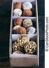 Sweet homemade pralines in the package, selective focus