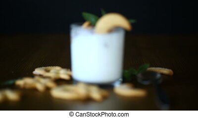 sweet homemade yogurt with cookies in a glass cup on a...