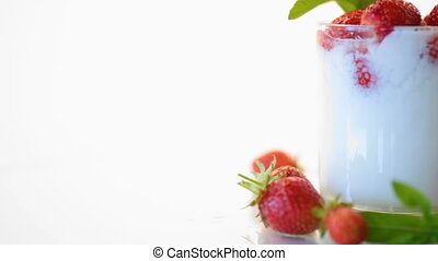 sweet homemade yogurt with fresh ripe strawberries isolated...