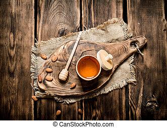 Sweet honey in the barrel on a wooden Board.