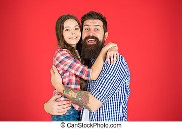Sweet hug. Man bearded father and cute little girl daughter on red background. Celebrate fathers day. Family values concept. Family bonds. Friendly relations. Father hipster and his daughter