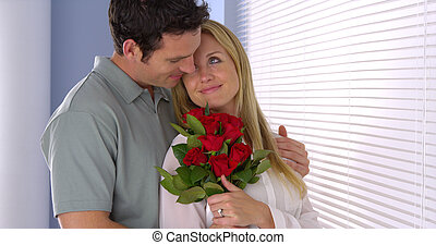Sweet husband surprises his wife with flowers