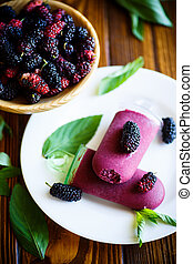 Sweet ice cream of black mulberry on a plate