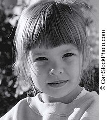 sweet innocence - pretty girl child in black and white with...