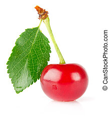 sweet juicy cherry with green leaf