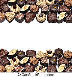 Sweet Life - Border of Different chocolate candies over...