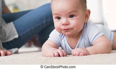 sweet little asian baby boy with mother - babyhood,...