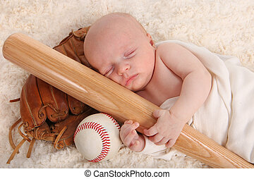 Little Baby Boy Holding a Baseball Bat