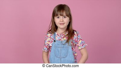 Sweet little girl 6-7 years old posing in dungarees jeans ...