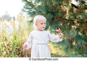 Sweet Little Girl Child Holding Freshly Picked Vegetables from the Garden
