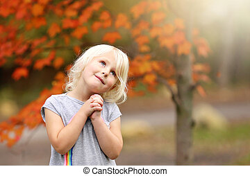 Sweet Little Girl Child Praying as She Looks up to the Sky