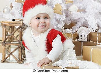 Sweet little girl dressed as Santa