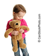 Sweet little girl holding a teddy bear