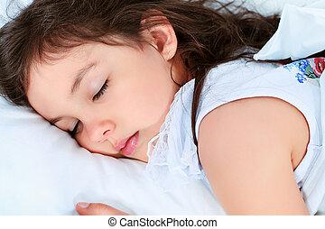 little girl - Sweet little girl is sleeping in a bed.
