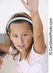 sweet little girl raising her hand