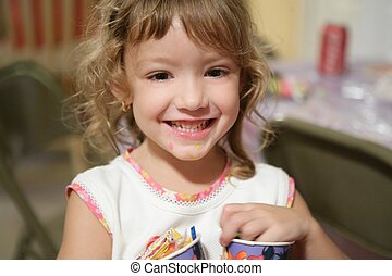 Sweet little girl smiling to camera