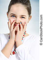sweet little girl with colored nail