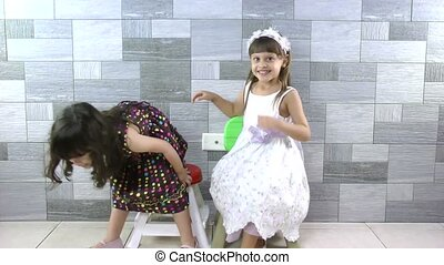 Sweet little girls inside house for