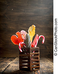 Sweet lollipops in a wooden stand.