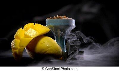 Mango hookah tobacco with fragrant swirling smoke
