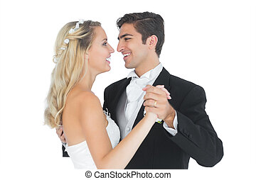 Sweet married couple dancing Viennese waltz smiling at each...
