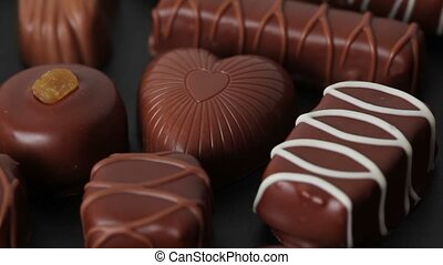 Sweet milk chocolates in form of heart turn around