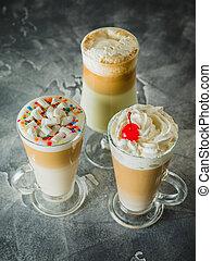 Sweet milkshake drinks with whipped cream, close up view