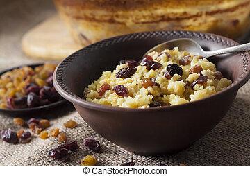 Sweet millet porridge with raisins and dried cranberries