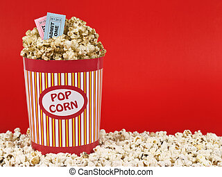 Sweet movie - A popcorn bucket over a red background. Movie...